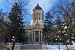 Winter view on Manitoba Legislature building. Winnipeg, Manitoba, Canada. This neoclassical building with the Golden Boy statue on its cupola was designed and built by Frank Worthington Simon in 1920