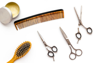 Instruments of male hairdresser barbershop top view on white background