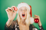 Funny woman in Santa Hat on green Background isolated. Banner for text. Copy cpase, text.