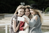 Three women taking selfie outdoor