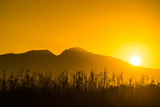 Sunrise over mountain hill