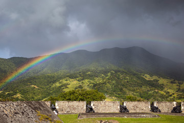 Rainbow above a cannons at Brimstone Hill Fortress on Saint Kitts. West Indies
