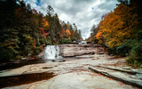 Triple Falls waterfall in fall color forest in the Appalachian mountains of North Carolina