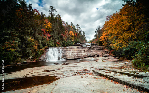 Triple Falls waterfall in fall color forest in the Appalachian mountains of North Carolina - 238166407
