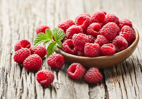 Raspberry on wooden background © Dionisvera