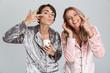 Quadro Two cheerful girls wearing pajamas standing