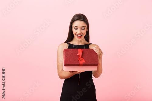 Leinwanddruck Bild Portrait of a beautiful young woman wearing black dress