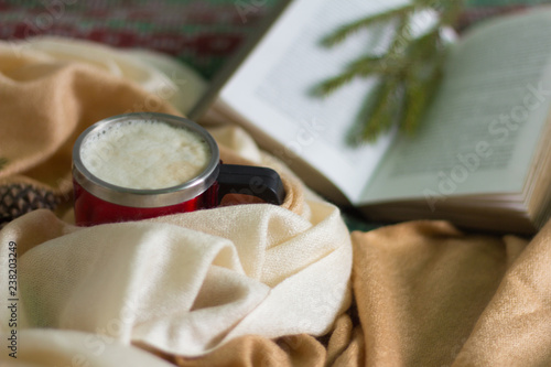 Cup of cappuccino and opened book on wooden background,holiday winter holidays