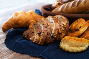baked French bread on wooden table