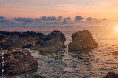 Dawn on the sea. The view from the water of the rising sun and the beautiful sky. Marine landscape. Odessa. Black Sea.