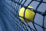 Tennis ball in net
