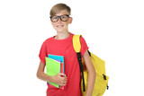 Young boy with notebooks and backpack on white background