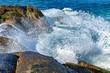 Quadro Waves crashing against rocks with spray and splashing water