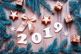 New Year 2019 festive background with 2019 figures, Christmas toys, blue fir tree branches and snowflakes - 2019 design