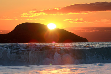 sunrise over the sea and mountin © Andrey