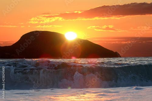 sunrise over the sea and mountin