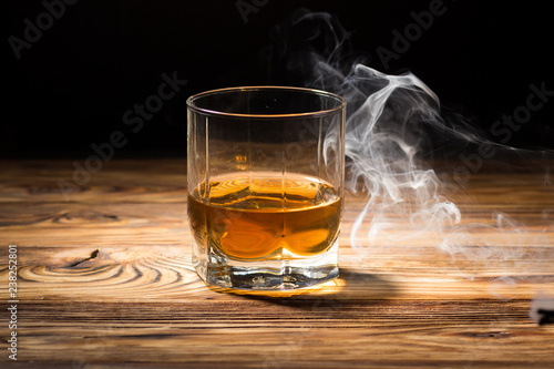 Glass of whiskey and smoke.