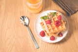 Waffles With raspberry in plate. Sweet dessert menu. Breakfast/Homemade waffles with raspberry, honey in plate on a old wooden table, top view