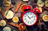 Alarm clock and Chrsitmas tea ingredients on jute background - 238271038