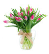 Pink fresh tulip flowers with green leaves in glass vase isolated on white background