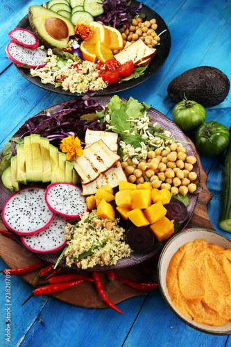 Foto Murales grilled tofu and dragon fruit buddha bowl with vegetable and humus