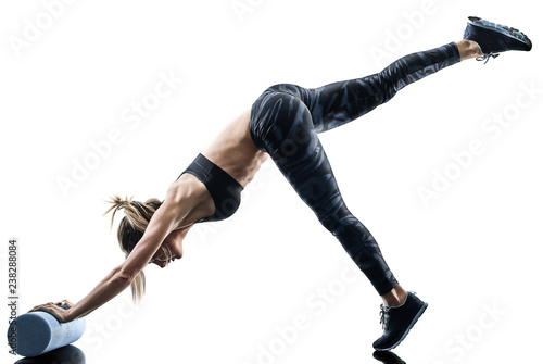 one caucasian woman exercising pilates fitness foam roller exercises isolated  silhouette on white background - 238288084
