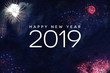 Leinwandbild Motiv Happy New Year 2019 Celebration Text with Festive Fireworks Collage in Night Sky