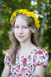 young girl in wreath of dandelions - 238319624