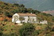 Traditional Spanish Finca in the countryside with views towards the Sierra de Mijas mountains near Fuengirola, Spain.