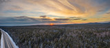 Aeria; drone panoramic view of early winter sunset, mixed forest of birches and pine trees, mountains on the background, colored dramatic sky with beautiful clouds, South Ural, Russia © Maria Kuzkina