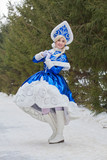 Granddaughter of Russian Grandfather Frost Snow Maiden on a walk in the woods. Russian Santa Claus.