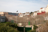 High security fences separate the Spanish exclave of Melilla, Spain from Morocco, north Africa, January 2015 - 238338409