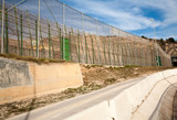 High security fences separate the Spanish exclave of Melilla, Spain from Morocco, north Africa, January 2015 - 238338473