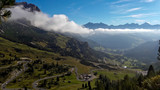 View from the Sella Group mountain range to the village of Colfosco, on background Sassongher mountain. Dolomites in northern Italy.