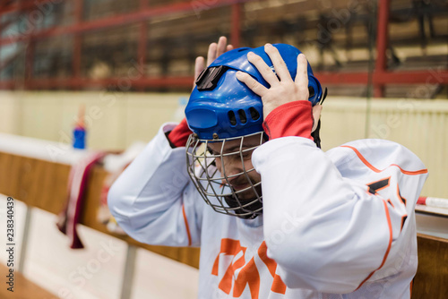 hockey player took hold of his head and was very upset that his team scored a goal