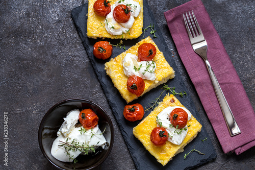 polenta with baked tomatoes and cream cheese - 238346270