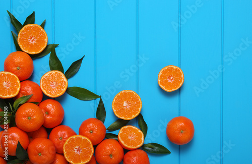 tangerines with green leaves - 238349438