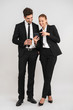 Full length of confident young business couple