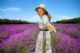 woman against lavender field calling for walk