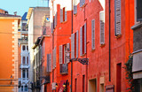 parma colorful orange   red facade of old building with windows in historical center street, Italy