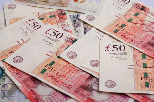Uk Pound Money Of United Kingdom Close Up On White Note