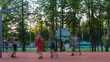 young people enthusiastically play street basketball