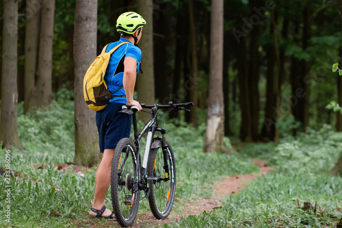 Cyclist in forest park