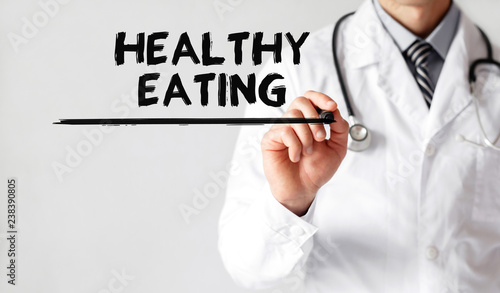Foto Murales Doctor writing word Healthy Eating with marker, Medical concept