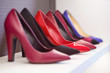 High-heeled shoes standing on the shelf.