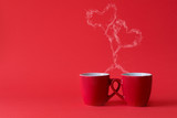 Cups of tea or coffee with steam in two heart shape on red background. Valentine's day celebration or love concept. Copy space