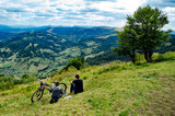 couple with bike on the mountains