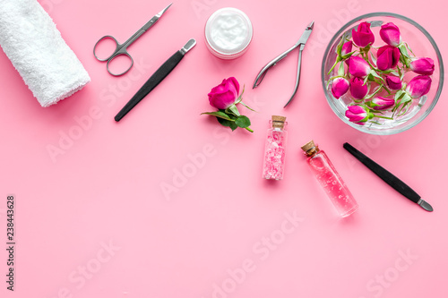 manicure and pedicure equipment for nail bar set on rose background ...