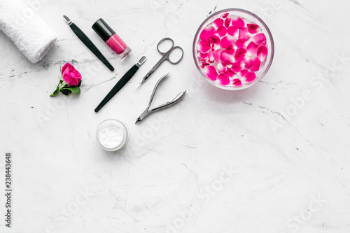 manicure and pedicure equipment for nail bar set on white stone ...