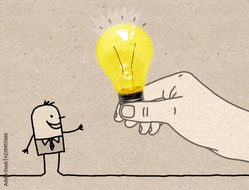 Leinwanddruck Bild Cartoon Big Hand Giving a Light Bulb to a Cartoon Man